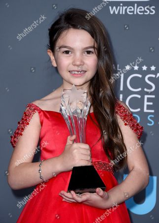 """Brooklyn Prince, winner of the award for best young actor/actress for """"the Florida Project"""", poses in the press room at the 23rd annual Critics' Choice Awards at the Barker Hangar, in Santa Monica, Calif"""