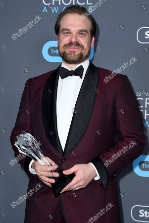"""David Harbour, winner of the award for best supporting actor in a drama series for """"Stranger Things"""", poses in the press room at the 23rd annual Critics' Choice Awards at the Barker Hangar, in Santa Monica, Calif"""