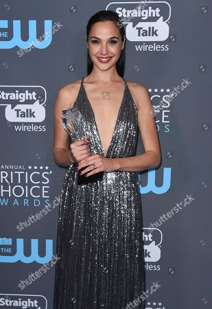 Gal Gadot, winner of the #SEEHER award, poses in the press room at the 23rd annual Critics' Choice Awards at the Barker Hangar, in Santa Monica, Calif