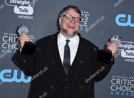 """Guillermo del Toro, winner of the award for best director for """"The Shape of Water"""" and best pictures for """"The Shape of Water, poses in the press room at the 23rd annual Critics' Choice Awards at the Barker Hangar, in Santa Monica, Calif"""
