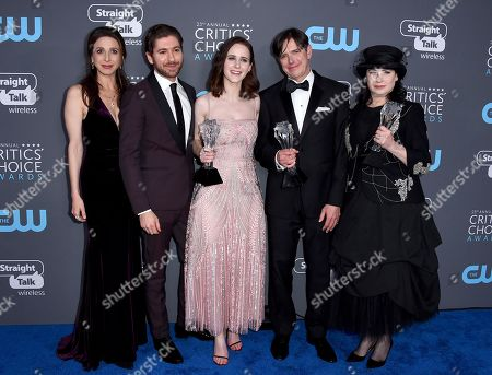 """Marin Hinkle, Michael Zegen, Rachel Brosnahan, Daniel Palladino, Amy Sherman-Palladino. Marin Hinkle, from left, Michael Zegen, Rachel Brosnahan, Daniel Palladino, and Amy Sherman-Palladino, winners of the award for best comedy series for """"The Marvelous Mrs. Maisel"""", pose in the press room at the 23rd annual Critics' Choice Awards at the Barker Hangar, in Santa Monica, Calif"""