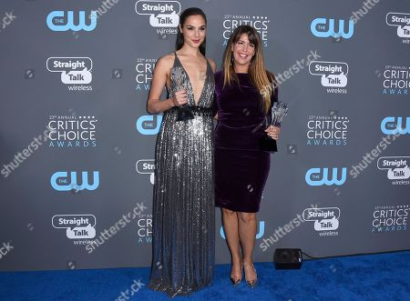 """Gal Gadot, Patty Jenkins. Gal Gadot, left, holding the #SEEHER award, and Patty Jenkins, holding the award for best action movie for """"Wonder Woman,"""" pose in the press room at the 23rd annual Critics' Choice Awards at the Barker Hangar, in Santa Monica, Calif"""