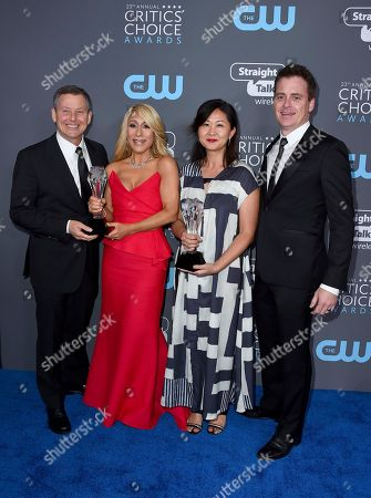 """Lori Greiner, second left, and the crew of """"Shark Tank"""", winners of the best structured reality series award, pose in the press room at the 23rd annual Critics' Choice Awards at the Barker Hangar, in Santa Monica, Calif"""