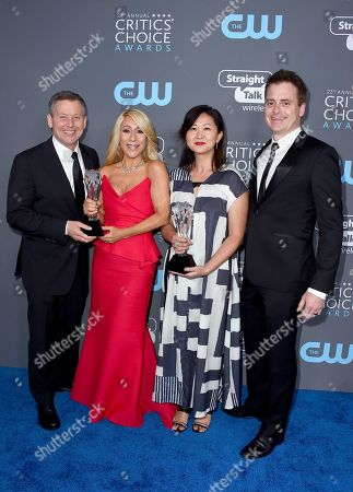 """Lori Greiner, second left, and the crew of """"Shark Tank"""", winners of the best structured reality series award pose in the press room at the 23rd annual Critics' Choice Awards at the Barker Hangar, in Santa Monica, Calif"""