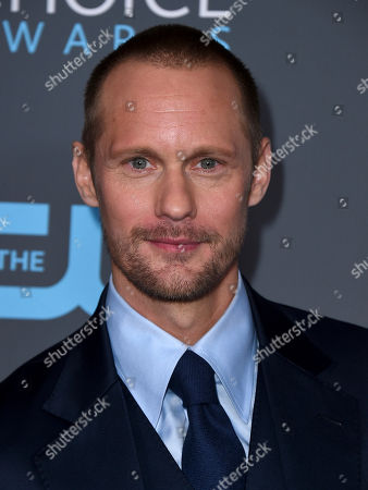 """Alexander Skarsgard, winner of the award for best supporting actor in a movie made for tv or limited series for """"Big Little Lies"""", poses in the press room at the 23rd annual Critics' Choice Awards at the Barker Hangar, in Santa Monica, Calif"""
