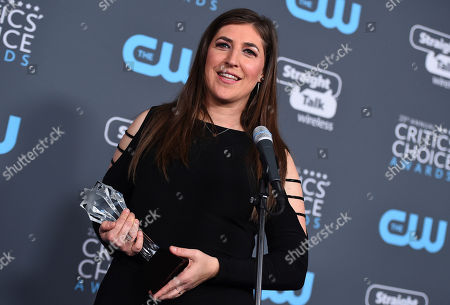 """Mayim Bialik, winner of the award for best supporting actress in a comedy series for """"The Big Bang Theory"""", speaks in the press room at the 23rd annual Critics' Choice Awards at the Barker Hangar, in Santa Monica, Calif"""