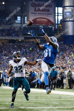Detroit Lions wide receiver Calvin Johnson (81) catches a 25-yard pass for a touchdown defended by Philadelphia Eagles strong safety Walter Thurmond (26) and cornerback Eric Rowe (32) during the first half of an NFL football game, in Detroit
