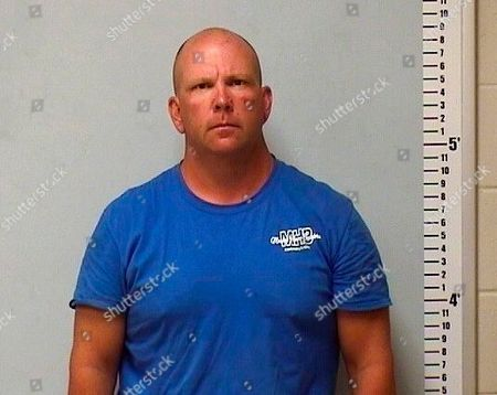 A photo provided by Olive Branch, Miss., police shows Mississippi state Sen. Chris Massey after he was arrested and charged with aggravated assault . Police say he wielded a shovel and hurt another man during a fight in an upscale Olive Branch subdivision