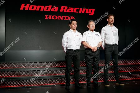 British racing driver Jenson Button (R) attends a news conference for Honda Motor Co., Ltd
