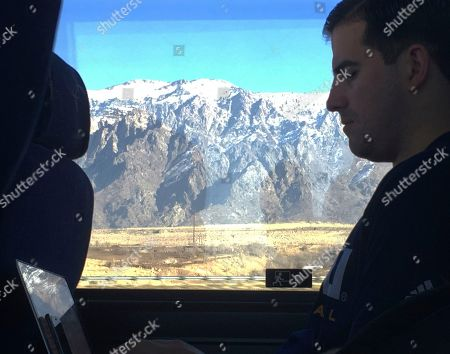 Northern Arizona assistant basketball coach Jason Sanchez goes over game film from the night before on a bus ride to Pocatello, Idaho. The Lumberjacks lost to Weber State by 40, then had to leave the next day on a two-hour bus ride for a game against Idaho State before driving back through Ogden to Salt Lake City
