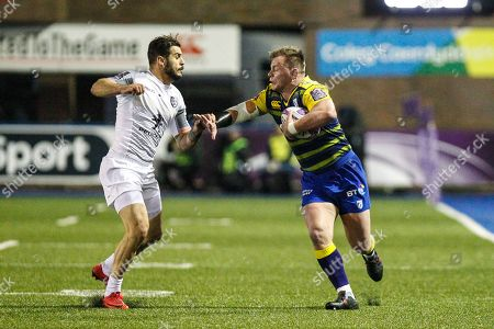 Matthew Rees of Cardiff Blues is tackled by Lucas Tauzin of Toulouse