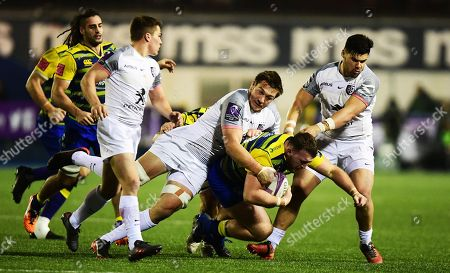 Cardiff Blues' Matthew Rees is tackled by Stade Toulousain's Thomas Ramos