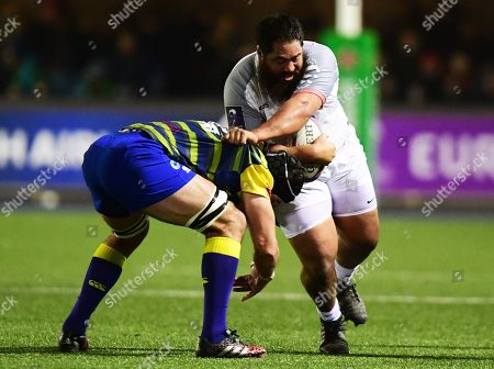 Stade Toulousain's Charlie Faumuina goes into contact with Cardiff Blues' Matthew Rees