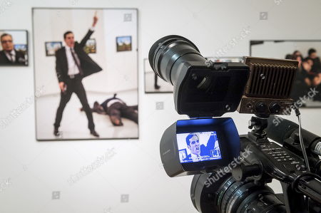 Stock Image of A photo by Turkish photographer Burhan Ozbilici is on display during the World Press Photo Foundation exhibition of the winners of the World Press Photo 2017 Photo Competition at the Centre of Contemporary Art Znaki Czasu in Torun, Poland, 12 January 2018. The picture taken on 19 December 2016 shows the assassination of the Russian ambassador to Turkey, Andrei Karlov and became the Photo of the Year of World Press Photo 2017.