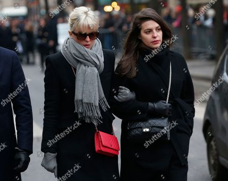 French actress Cecile Cassel, left, arrives at the Montmartre cemetery for French singer France Gall's burial in Paris, Friday, Jan.12, 2018. French pop singer France Gall, who shot to fame in the 1960s by winning the Eurovision Song Contest then produced hits and sold millions of albums over a four-decade career, died last Sunday. She was 70