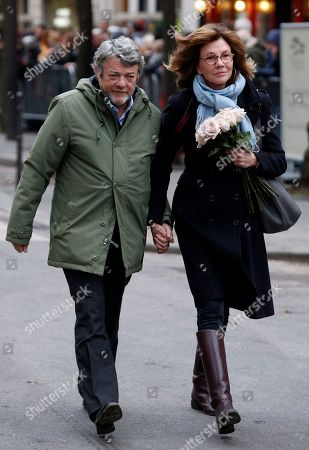 Former French Environment minister Jean-Louis Borloo and his wife Beatrice Schonberg arrive at the Montmartre cemetery for French singer France Gall's burial in Paris, Friday, Jan.12, 2018. French pop singer France Gall, who shot to fame in the 1960s by winning the Eurovision Song Contest then produced hits and sold millions of albums over a four-decade career, died last Sunday. She was 70