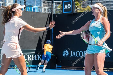 CoCo Vandeweghe of the USA and Laura Robson of the United Kingdom hi five during the doubles round 1 of the Australian Open Tennis Grand Slam.