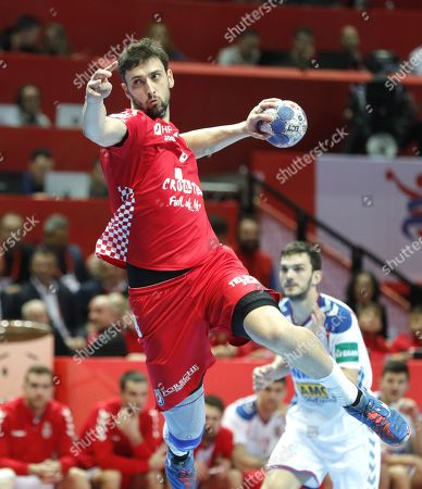 Marko Kopljar (L) of Croatia  in action against  Milan Jovanovic (R) of  Serbia  during the EHF European Men's Handball Championship 2018 group A match between Croatia  and Serbia in Split , Croatia, 12 January 2018.