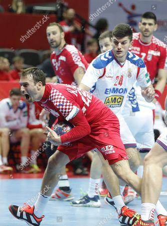 Igor Karacic (L) of Croatia  in action against  Milan Jovanovic (R) of  Serbia  during the EHF European Men's Handball Championship 2018 group A match between Croatia  and Serbia in Split, Croatia, 12 January 2018.