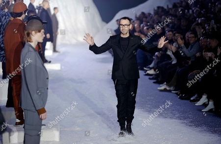 Designer Alessandro Sartori acknowledges the applause at the end of the Ermenegildo Zegna men's Fall-Winter 2018-19 collection that was presented in Milan, Italy, Friday, Jan.12, 2018