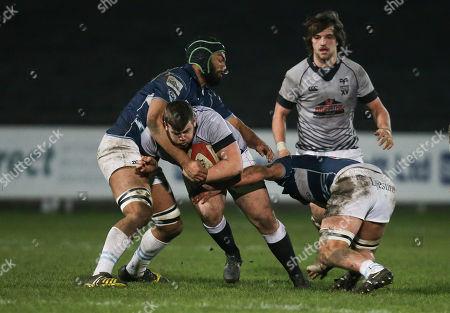Luke Davies of Ospreys Premiership Select XV takes on Jordan Onojaife of Bedford Blues