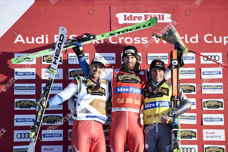 (l-r) Marc Bischofberger, SUI, Alex Fiva, SUI, and Jean Frederic Chapuis, FRA, pose for photographers on the medals podium after the men?s freestyle ski cross finals in Idre Fjall, Sweden on Saturday, 13 January, 2018.