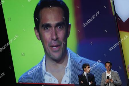 Former Spanish riders Alberto Contador (R) and Perico Delgado (2-R) talk during the presentation of the 2018 Vuelta a Espana cycling race in Malaga, Andalusia, Spain, 13 January 2018. The 2018 Vuelta a Espana cycling race runs from 25 August to 16 September 2018.