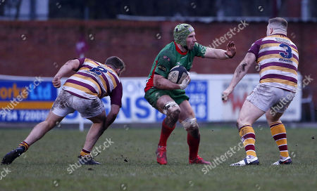 Eoghan Grace, Captain of Plymouth Albion hands off Adam Lewis of Fylde during the National Division 1 match between Fylde v Plymouth Albion at the Woodlands Memorial Ground, on January 13 2018, Lytham St. Annes, Lancashire, UK.