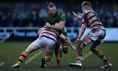 Ed Holmes of Plymouth Albion is tackled by Adam Lewis of Fylde during the National Division 1 match between Fylde v Plymouth Albion at the Woodlands Memorial Ground, on January 13 2018, Lytham St. Annes, Lancashire, UK.