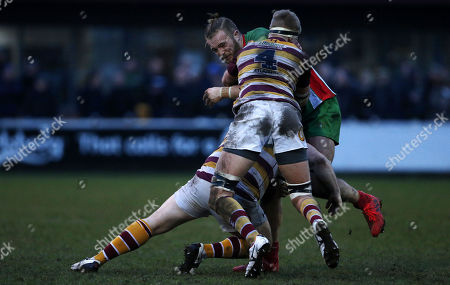 Ed Holmes of Plymouth Albion is tackled by Adam Lewis of Fylde and Nick Ashcroft of Fylde during the National Division 1 match between Fylde v Plymouth Albion at the Woodlands Memorial Ground, on January 13 2018, Lytham St. Annes, Lancashire, UK.