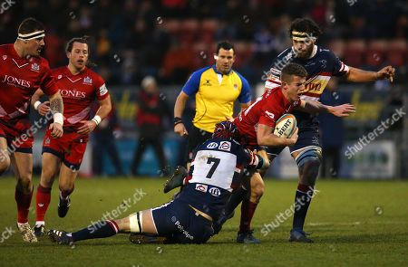 Billy Searle of Bristol Rugby is tackled by Michael Hills of Doncaster Knights