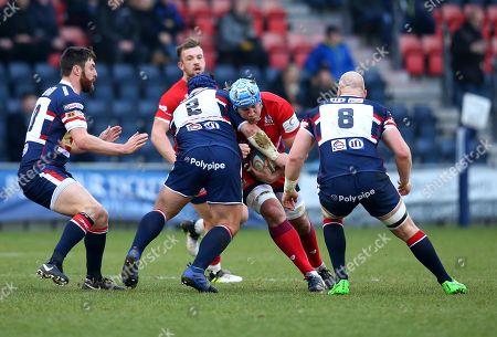 Jordan Crane of Bristol Rugby is tackled by Ben Hunter of Doncaster Knights