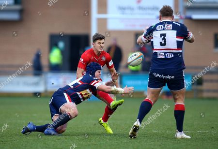 Callum Sheedy of Bristol Rugby has a kick charged down by Ben Hunter of Doncaster Knights