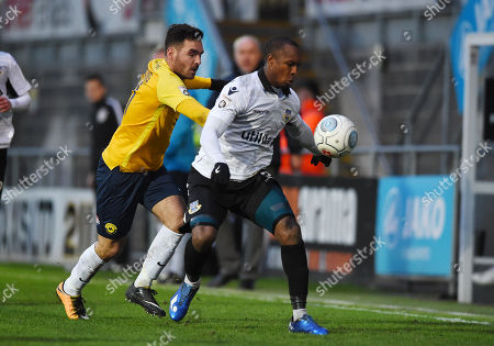 Gavin Hoyte of Eastleigh competes for the ball with Jake Gosling of Torquay United, during the Vanarama National League match between Torquay United and Eastleigh at Plainmoor, Torquay, Devon on January 13