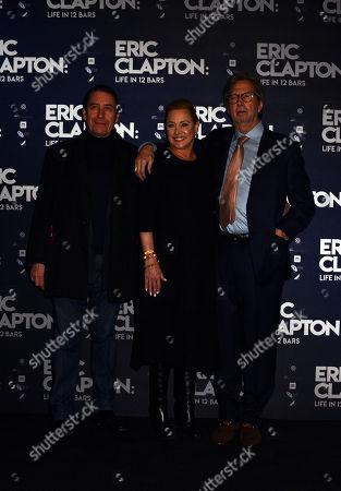 Guest, Lili Fini Zanuck and Eric Clapton