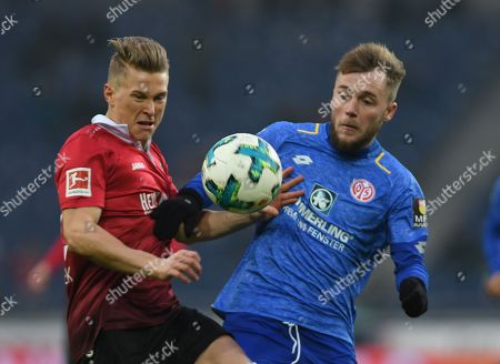 Hannover's Matthias Ostrzolek (L) in action against Mainz's Alexandru Maxim (R) during the German Bundesliga soccer match between Hannover 96 and Mainz 05 in Hannover, Germany, 13 January 2018.