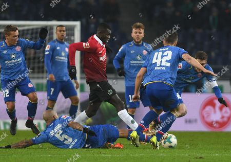 Hannover's  Ihlas Bebou (C) in action against Mainz's Nigel de Jong (down) during the German Bundesliga soccer match between Hannover 96 and Mainz 05 in Hannover, Germany, 13 January 2018.