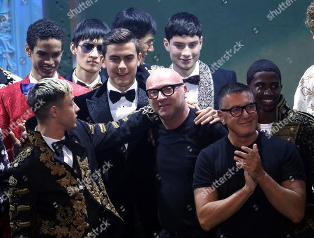 Fc Juventus forward Paulo Dybala  (L) with  fashion designer Domenico Dolce (C) and Stefano Gabbana applause after the Italian fashion label Dolce&Gabbana show during the Milan Fashion Week, in Milan, Italy, 13 January 2018. The Men's Fall/Winter 2018/19 collections are presented from 12 to 15 January.