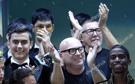 Fc Juventus forward Paulo Dybala (L) with  fashion designer Domenico Dolce (C) and Stefano Gabbana applause at the end of the Italian fashion label Dolce&Gabbana show during the Milan Fashion Week, in Milan, Italy, 13 January 2018. The Men's Fall/Winter 2018/19 collections are presented from 12 to 15 January.