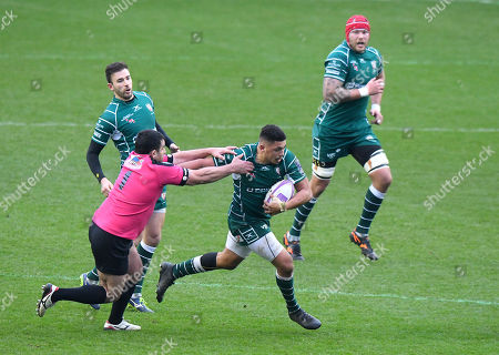 Isaac Curtis-Harris of London Irish breaks through the missed tackle by Grigory Tsnobiladze of Krasny Yar during the European Rugby Challenge Cup Pool 4 match between London Irish and Krasny Yar at Madejski Stadium on January 13th 2018 in Reading, Berkshire, England. (Photo by Gareth Davies/PPAUK)