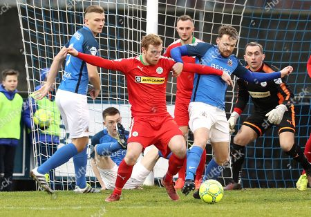 Glenavon vs Cliftonville. Glenavon's Andrew Hall with Ross Lavery of Cliftonville