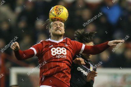 Matthew Mills of Nottingham Forest heads the ball ahead of Jack Grealish of Aston Villa