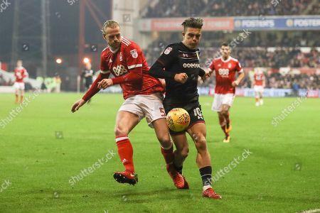 Matthew Mills of Nottingham Forest and Jack Grealish of Aston Villa