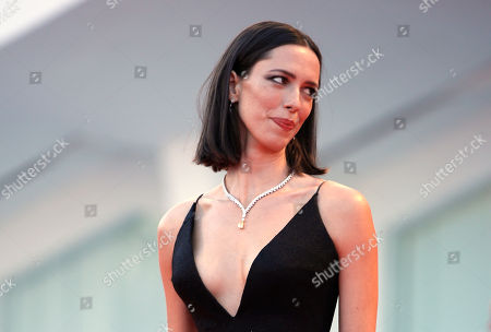 "Actress Rebecca Hall poses for photographers at the premiere of the film 'mother!' at the 74th edition of the Venice Film Festival in Venice, Italy, Hall says she's donating her salary from the latest Woody Allen film to Time's Up. Hall said on Instagram she was hired for Allen's ""A Rainy Day in New York"" but is ""profoundly sorry"" and ""regrets"" her decision to work with the filmmaker. She said, she reconsidered the job after reviewing molestation accusations by Allen's daughter Dylan Farrow"
