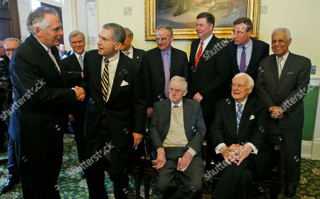 Terry McAuliffe, Bob McDonnell, Tim Kaine, George Allen, Mark Warner, L. Douglas Wilder, Chuck Robb, Linwood Holton, Gerald Baliles. Outgoing Virginia Gov. Terry McAuliffe, left, shakes hands with former Governor Chuck Robb as former Governors, Bob McDonnell, second from left, Sen. Tim Kaine, top center, George Allen, third from right, Sen. Mark Warner, second from right, L. Douglas Wilder, right, seated Linwood Holton, and Gerald Balliles, right, prior to Northam taking his oath of office at the Capitol in Richmond, Va