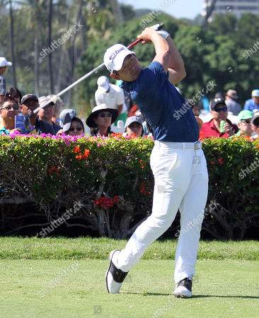 Andrew Yun tees off from the 10th hole during the second round of the 20th anniversary of the Sony Open at the Waialae Country Club in Honolulu, Hawaii - Michael Sullivan/CSM