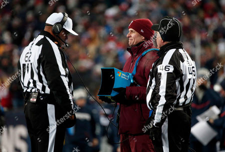 Ron Torbert, Perry Paganelli. Referee Ron Torbert, left, reviews a video replay on the sideline during the first half of an NFL divisional playoff football game between the New England Patriots and the Tennessee Titans, in Foxborough, Mass. At right is back judge Perry Paganelli