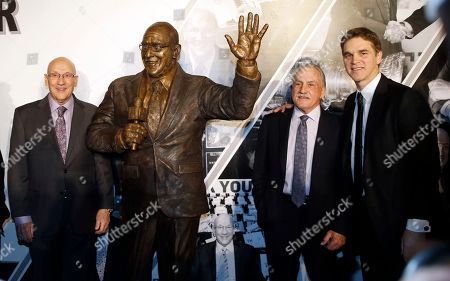 Bob Miller, Luc Robitaille, Rogie Vachon. A statue honoring former Los Angeles Kings broadcaster Bob Miller, left, is unveiled in Star Plaza outside Staples Center, as Miller is joined by former Kings Luc Robitaille, right, and Rogie Vachon, before the Kings' NHL hockey game against the Anaheim Ducks in Los Angeles