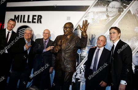 Rob Blake, Pete Weber, Bob Miller, Rogie Vachon, Luc Robitaille. From left to right, former King Rob Blake, former Kings play-by-play broadcaster Pete Weber, currently with the Nashville Predators, Bob Miller, former Kings goalie, Rogie Vachon and president of the Kings, Luc Robitaille pose for photographers with a statue honoring Los Angeles Kings broadcasting legend and Hockey Hall of Famer Bob Miller after it is unveiled before an NHL hockey game against the Anaheim Ducks in Los Angeles