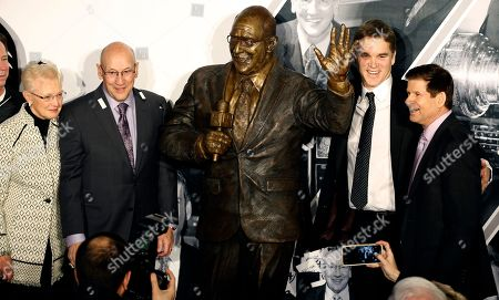 Bob Miller, Judy Miller, Jim Fox, Luc Robitaille. A statue honoring Los Angeles Kings broadcasting legend Bob Miller, second from left, with his wife, Judy Miller, left, and Kings broadcaster, Jim Fox, right, with president of the Kings, Luc Robitaille, is unveiled before an NHL hockey game against the Anaheim Ducks in Los Angeles